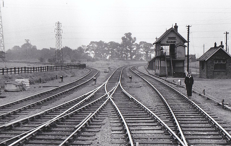 BOURNE - West Junction, the long closed line to Essendine and ECML bearing off to the left. Seen here in August 1958, 6 months before closure. When I was at Grammar School, we did our cross country runs through those tress in the background.