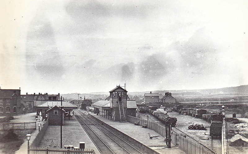 SHERINGHAM - Looking east from the road bridge before the 1906 remodelling and enlargement of the station. The original signalbox is rather grand but was not best situated to operate the new goods yard at the western end of the station.