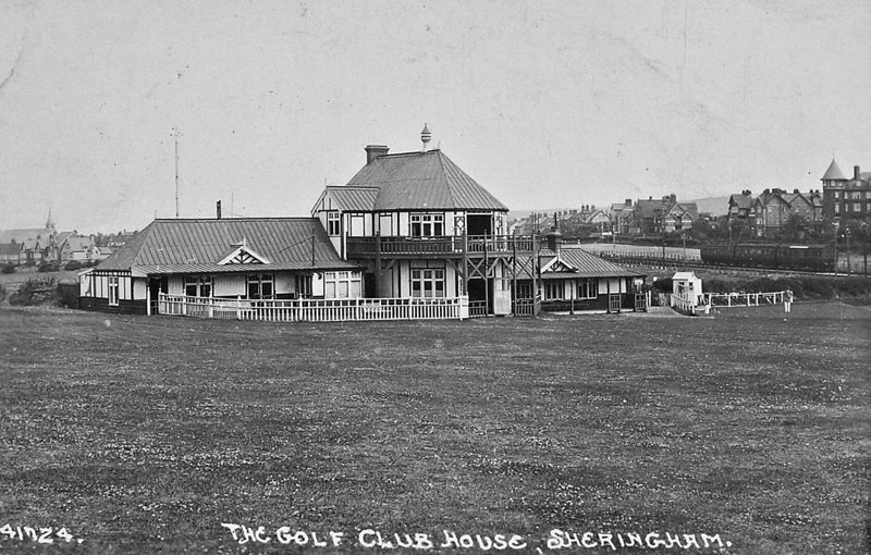 SHERINGHAM GOLF COURSE CLUBHOUSE - I'm not in the least bit interested in golf but note the coaches stabled in the right side of shot, one complete with rooftop destination board.