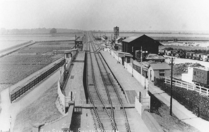 SOUTH WITHAM - A brand new station built entirely of wood, seen here just after opening, looking towards Saxby. The yard on the right caters to the extensive ironstone traffic from this area, the tower being a wagon drop. The ironstone quarry was just behind this tower beyond the hedge line.