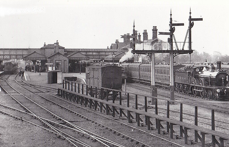 SPALDING - Although technically a GNR Station, the M&GN enjoyed full use of the generous facilities at Spalding - indeed, any M&GN train calling there was obliged to reverse direction and change engines, hence the presence of an M&GN locoshed. Seen here in about 1920 with an M&GN train departing on the right, 4-4-0 No.4 I think.