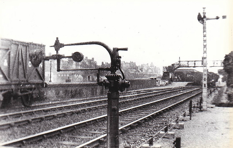 SHERINGHAM - Looking west in about 1905, showing the Whittaker Automatic Tablet Exchanger in operating position. I presume the signalman or a box lad operated this.