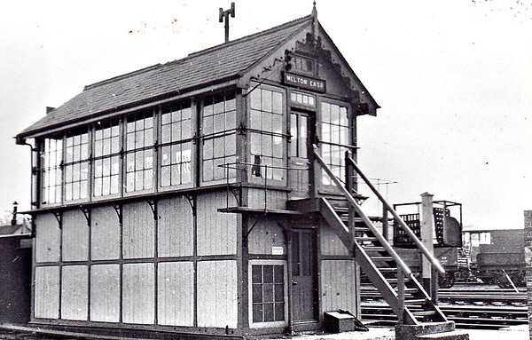 MELTON CONSTABLE - East Signalbox, controlling the exit from the station to the junction for Norwich and Yarmouth. Note the tablet exchange apparatus on the pole by the fott of the steps.