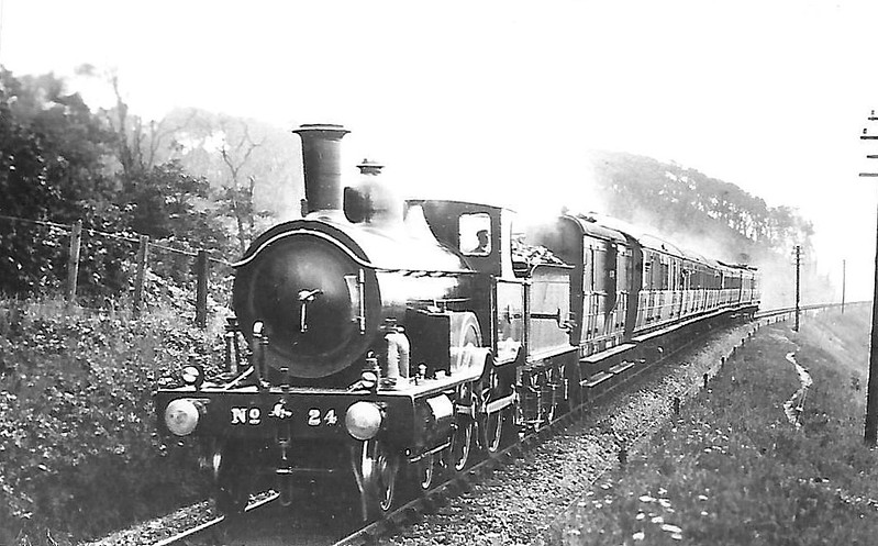 M&GN - 24 - Lynn & Fakenham Railway M&GN Class A 4-4-0 - built 1881 by Beyer Peacock Ltd. as L&FR No.24 - withdrawn by 1936 with boiler problems - frames were mated with boiler from No.25, numbered 025 - remainder scrapped - note extended tablet catcher arm.