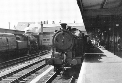 BR - 69694 - Hill GER/LNER Class N7 0-6-2T - built 08/27 by Beardmore & Co. as LNER No.2654 - 08/46 to LNER 9694, 06/48 to BR No.69694 - 11/60 withdrawn from 30F Parkston Quay - seen here at Kings Lynn with the shuttle to South Lynn in August 1958.