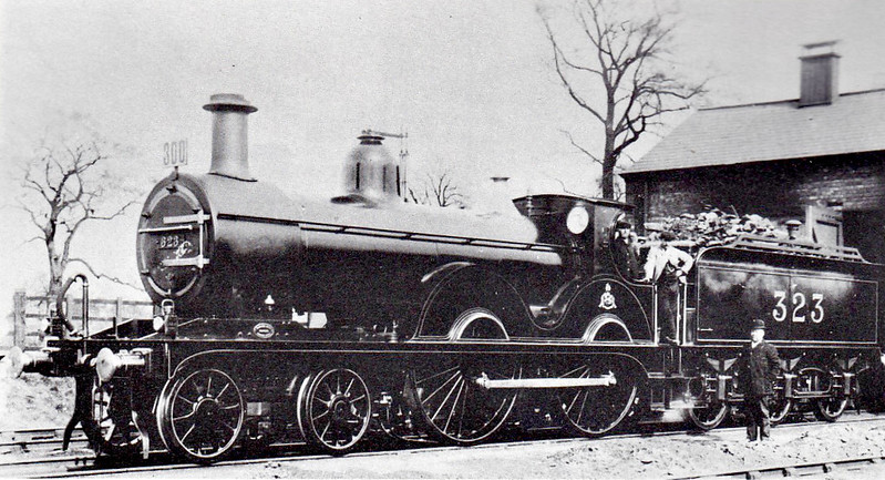 LMS - 323 - Johnson MR Class 1P 4-4-0 - built 1877 by Dubs & Co. as MR No.1341 - 1907 to MR No.323 - 1929 withdrawn - seen here at Bourne Shed after working in a special in 1929, just a couple of months before withdrawal..