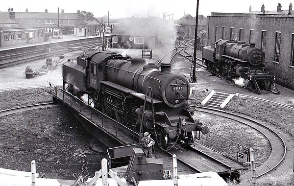 BR - 43145 - BR Ivatt Class 4MT 2-6-0 - built 09/51 by Doncaster Works - withdrawn 01/65 from 40E Colwick - seen here at Melton Constable with sister No.43146 to the right.