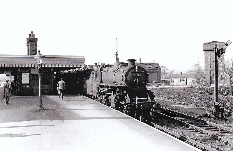 BR - 43085 - BR Ivatt Class 4MT 2-6-0 - built 11/50 by Darlington Works - 01/65 withdrawn from 41E Staveley - 35A New England loco from new to 01/58 - seen here about to depart from Bourne on a Spalding train. Taken not long before closure I think.