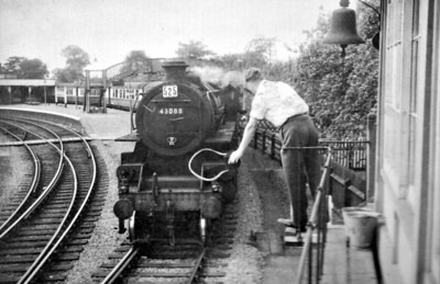 BR - 43088 - BR Ivatt Class 4MT 2-6-0 - built 12/50 by Darlington Works - 12/67 withdrawn from 10D Lostock Hall - 35A New England loco from new to 03/63 - seen here departing Sutton Bridge on an eastbound Special in 1958.