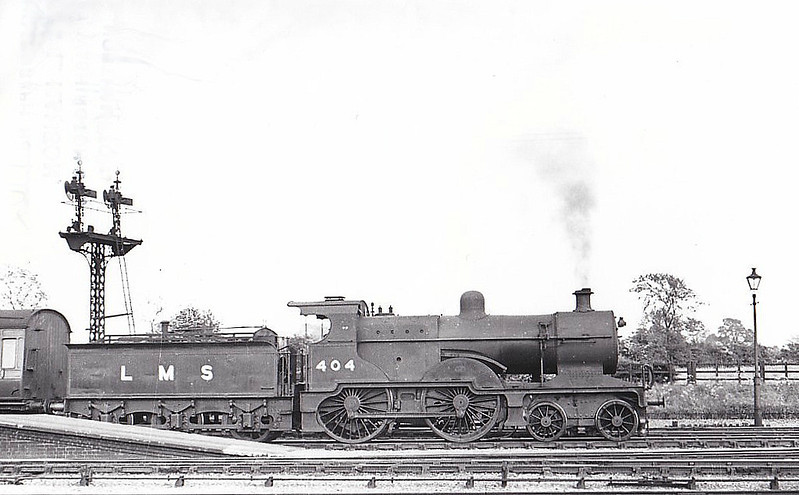 LMS - 404 - Johnson MR Class 2P 4-4-0 - built 04/1892 by Sharp Stewart & Co. as MR No.2184 - 1907 to MR No.404, 10/51 to BR No.40404 - 10/57 withdrawn from 17A Derby - seen here at Bourne on a westbound train. This end of the line was commonly worked by LMS engines which usually came off at Bourne or Spalding.