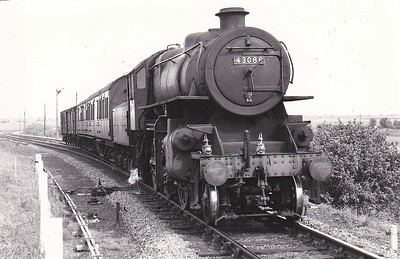 BR - 43088 - BR Ivatt Class 4MT 2-6-0 - built 12/50 by Darlington Works - 12/67 withdrawn from 10D Lostock Hall - 35A New England loco from new to 03/63 - seen here approaching Sutton Bridge on a local.