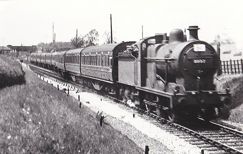LMS - 3937 - Fowler LMS Class 4F 0-6-0 - built 1921 by Armstrong Whitworth & Co. - 01/49 to BR No.43937 - 07/63 withdrawn from 9G Gorton - seen here entering the single track section at Edmondthorpe Station, 1936, on an SSO Special.