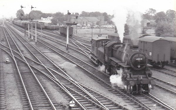 BR - 43085 - BR Ivatt Class 4MT 2-6-0 - built 11/50 by Darlington Works - 01/65 withdrawn from 41E Staveley - 35A New England loco from new to 01/58 - seen here at Spalding heading north out of the sidings to the west of the mainline.