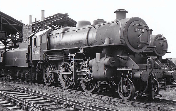 BR - 43091 - BR Ivatt Class 4MT 2-6-0 - built 12/50 by Darlington Works - 06/65 withdrawn from 41D Canklow - 31D South Lynn loco from new to 03/59 - seen here at South Lynn with sister No.43095, 06/58.