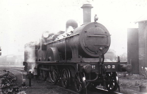 LNER - 0 2 - Johnson Class C LNER Class D53 4-4-0 - built 1894 by Sharp Stewart & Co., Works No.4002, as M&GN No.2 - 1910 rebuilt, 1931 rebuilt to Class D53 with Belpaire boiler - 01/37 to LNER No.02 - 05/43 withdrawn from Yarmouth Beach - seen here at Melton Constable in May 1938.