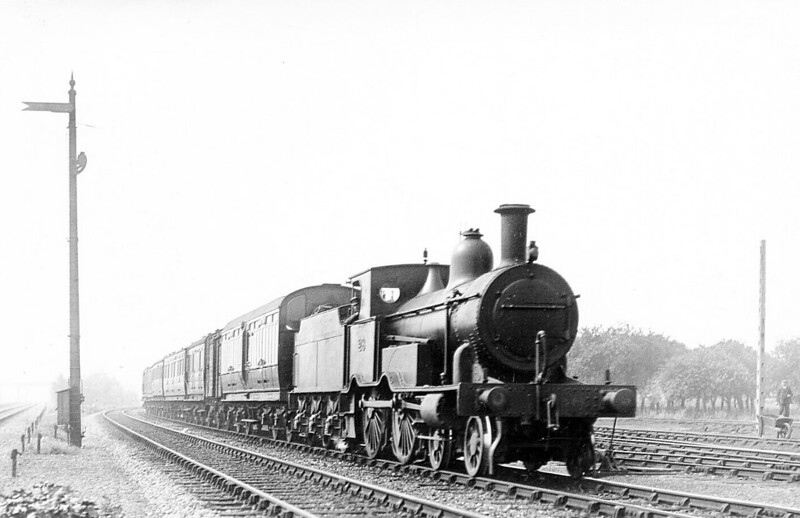 M&GN - 28 - Eastern & Midland Railway M&GN Class A 4-4-0 - built 1883 by Beyer Peacock Ltd., Works No.2341, as E&MR No.28 - LNER No.028 not applied - 02/38 withdrawn - note Fowler pattern tender - seen here arriving at Spalding with a train from Bourne.