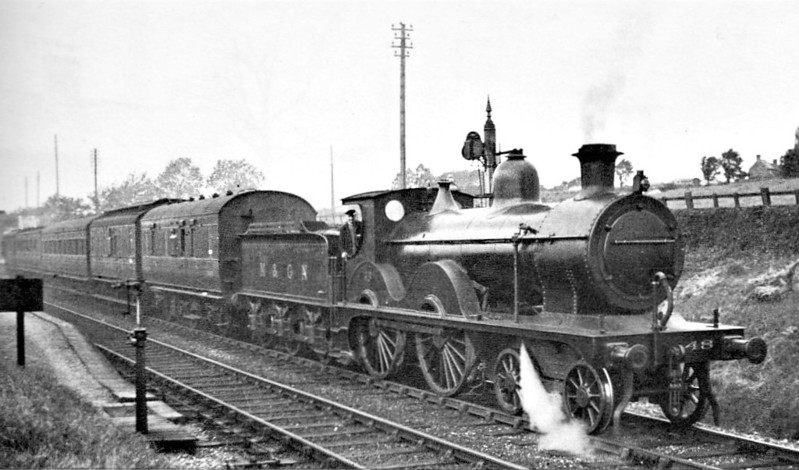 M&GN - 48 - Johnson Class C LNER Class D52 4-4-0 - built 1894 by Sharp Stewart & Co., Works No.3998, as M&GN No.48 - 1911 rebuilt - LNER No.048 not applied - 11/37 withdrawn from New England - seen here at Edmondthorpe and Wymondham on an eastbound train in 1934.