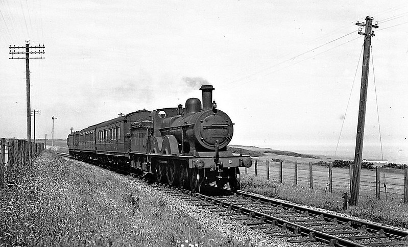 M&GN -  6 - Johnson Class C LNER Class D53 4-4-0 - built 1894 by Sharp Stewart & Co., Works No.4006, as M&GN No.6 - 1912 rebuilt, 1930 rebuilt with Belpaire boiler to Class D53 - 10/37 to LNER No.06 - 03/44 withdrawn - seen here passing Sheringham Golf Course.
