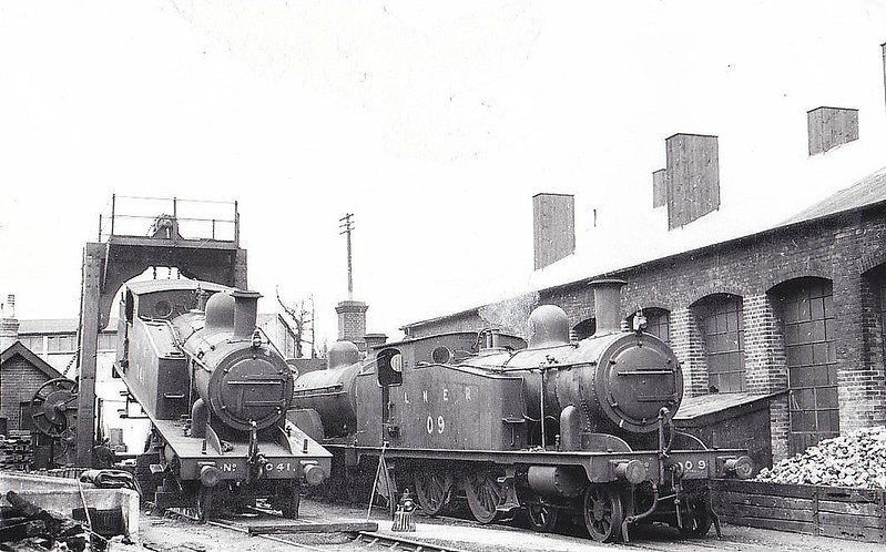 LNER - 0 9 - Marriott M&GN Class A LNER Class C17 4-4-2T - built 1909 by Melton Constable Works as M&GN No.9 - 1933 tank tops cut down to improve visibility - 1936 to LNER No.09 - 07/44 withdrawn from Melton Constable - seen here at Melton Constable Works with sister No.041 having her wheelsets changed, 03/39.