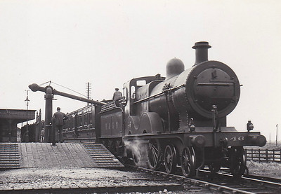 M&GN - 46 - Johnson Class C LNER Class D54 4-4-0 - built 1894 by Sharp Stewart & Co., Works No.3996, as M&GN No.46 - 1915 rebuilt, 1932 rebuilt with Belpaire boiler to Class D54 - 07/37 to LNER No.046 - 03/43 withdrawn from South Lynn, where seen taking water in June 1936.