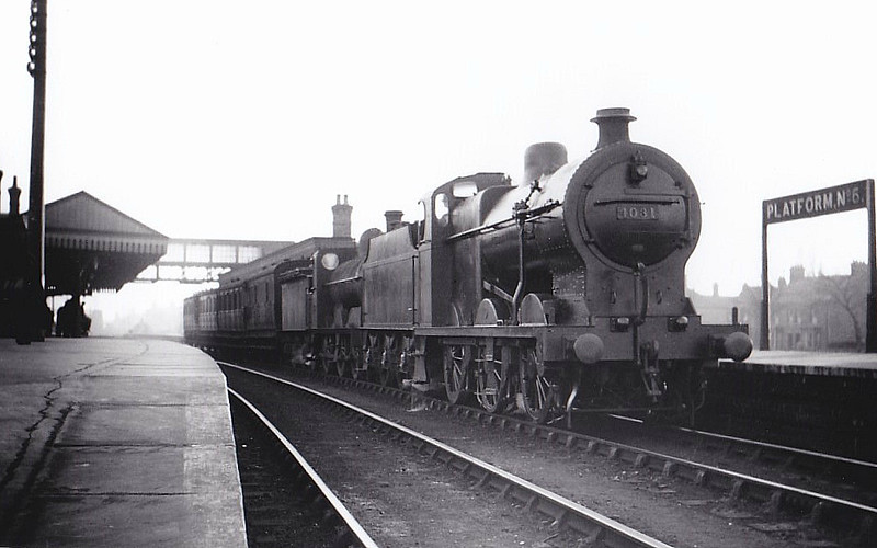 LMS - 4031 - MR Fowler Class 4F 0-6-0 - built 12/24 by Derby Works - 04/50 to BR No.44031 - 05/60 withdrawn from 17A Derby - seen here piloting M&GN Class D 0-6-0 on a Bourne - Spalding train at Spalding.