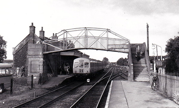 BRANDON - Last stop before Thetford on the Ely - Norwich line, a station that has benefitted greatly from the new hourly Cambridge - Norwich service introduced by Anglia Trains in 2007, passenger figures having more than doubled since then. Note the footbridge - very similar to those found on the M&GN. Seen here looking west in the bad old days of July 1974with a 3-car Class 101 on one of the infrequent Ely - Norwich - Ely services.