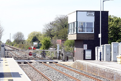 HUBBERTS BRIDGE - The level crossing and signal box, 26/04/21. I wish Network Rail good luck in getting rid of this set up - the drain is five feet to the left, out of shot, level crossing, crossroads behind the box and station platform adjacent!