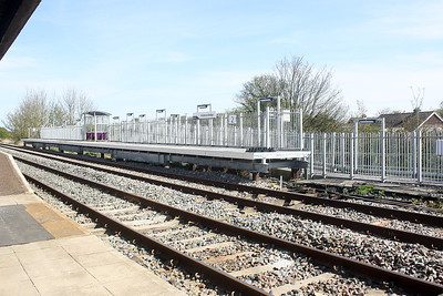 HUBBERTS BRIDGE - The new westbound platform, only recently completed. The old one, made of plywood, was very rickety. Note the platform is raised on piles - this is because Hammond Beck Drain is literally five feet beyond the platform and the bank will bear no weight. According to the signalman, they currently have one passenger a day, a girl who goes to school in Boston (and presumably comes home again!)