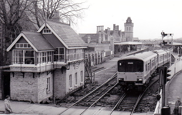 LINCOLN CENTRAL - Looking east from the High Street footbridge as Class 150 114, strengthened to three cars by the addition of a Class 150/2 centre car, departs for Birmingham in March 1989.