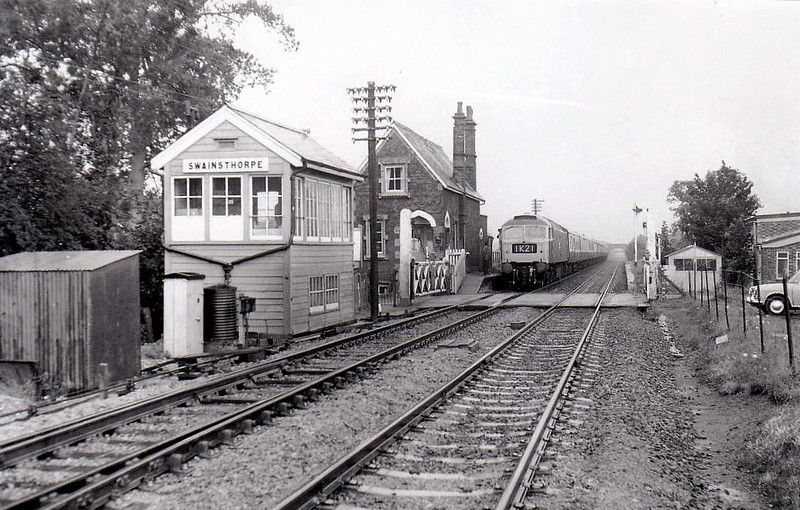 SWAINSTHORPE - opened in March 1850 on the Great Eastern Mainline from Norwich to Liverpool Street - closed to passenger traffic in July 1954 and to all traffic in July 1964 - seen here in the early 1970's. Why is the train running on the wrong line?