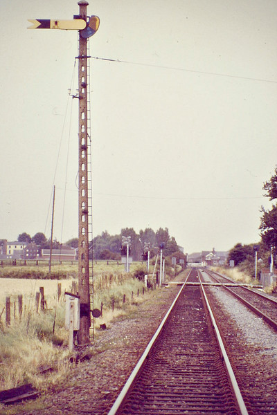 WAINFLEET - the Up Distant, a Great Northern pattern somersault signal on an LNER concrete post, 09/88.