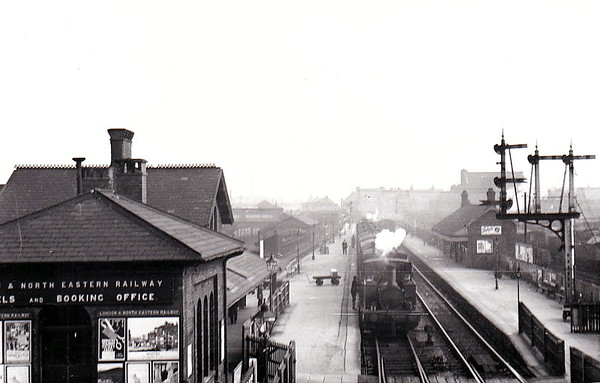 GRIMSBY DOCKS - on the line from Grimsby Town to Cleethorpes, this once important station is now just a single platform with plain track. It now only plays host to the Barton-on-Humber - Cleethorpes service and only handles about 5000 passenger journeys per year. Seen here in the 1930's.