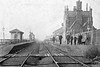 ANCASTER - On the Nottingham - Sleaford line, opened in 1857, the station is still open. I spent many happy hours here in the 1970's, revising for my Degree exams - it was quieter than a two-room flat with a wife and baby! Seen here looking west with staff assembled plus a man and his dog!, probably around 1900