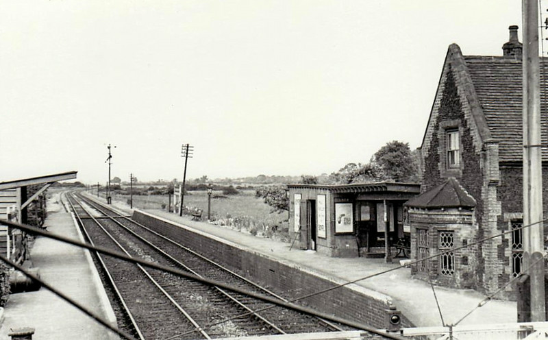 STOW BARDOLPH - First station north of Downham Market on the line to Kings Lynn, opened in 1846 and closed in 1963. Note signals for both directions on the one post. Also station house built at road level, not platform level.