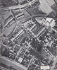 WISBECH - Aerial photo of the east bank of the River Nene, just visible in the bottom left corner, in 1947. The GER harbour lines were extensive and this picture shows the gasworks and it's associated sidings and above them the wagon marshalling lines behind the factory. The lines continue a considerable distance further to the left and to the right they head back through the park to Wisbech East. Most of this gone now, of course, except the building on the right which is the Clarkson Hospital.