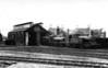 EAST DEREHAM - The little two-road engine shed at Dereham in 1937 with Class J15 0-6-0 No.7550 and Class F3 'Gobbler' No.8049 standing outside.