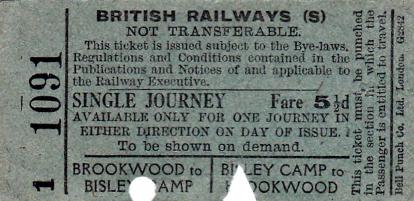 BRITISH RAILWAYS TICKET - BROOKWOOD to BISLEY CAMP - Day Return Ticket, fare 5 1/2d in each direction. The branch from Brookwood to Bisley opened in July 1890 to service the new National Rifle Assocoation Camp at Bisley. It was built to tramway standards, was about 2.5 miles long and operated by the LSWR. It closed in 1954.