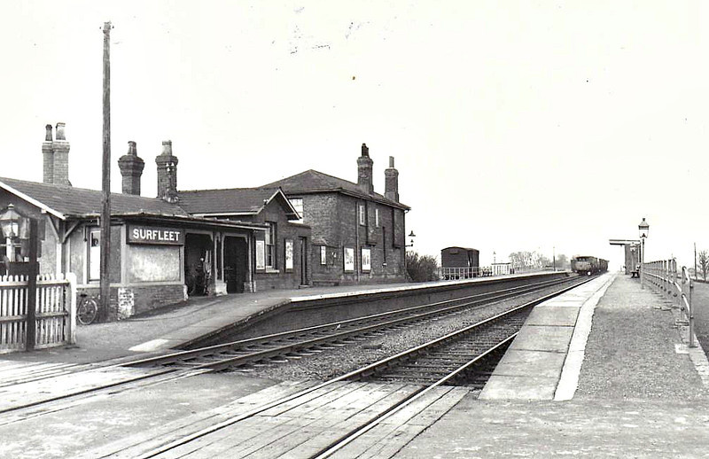 SURFLEET - First station north of Spalding on the GNR line to Boston, opened in 1849, closed to passengers in 09/61 and to freight in 12/63. On closure, the site was in use as a transport yard until 1994, at which time the station building still stood, but the whole site was then bulldozed to make way for the new A16 road. A typically sparse GNR rural station.