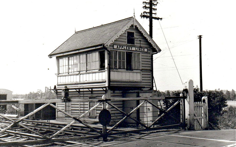 APPLEBY - The signalbox and level crossing at Appleby in Lincolnshire, first station east of Scunthorpe on the line from Gunness to Wrawby Junction and thence to Grimsby and Immingham. 'Lincs' was added to the name after the Grouping to avoid confusion with several stations of the same name. The station was opened in October 1866 and closed in June 1967, even though this line is one of the busiest in the country.