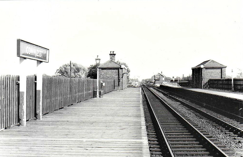 CONINGSBY - First station on the Woodhall Junction - Little Steeping cut-off line that allowed Lincoln trains direct access to Skegness without the need to run round at Boston. Built of timber on an embankment, closed to all traffic in October 1970.