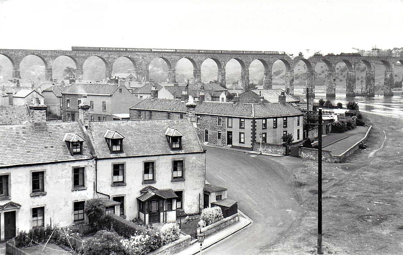 BERWICK-ON-TWEED - The Royal Border Bridge connects Berwich-on-Tweed with Tweedmouth. Built between 1847 and 1850, it is 659 yards long and is seen here with an A4 crossing it in 08/56.