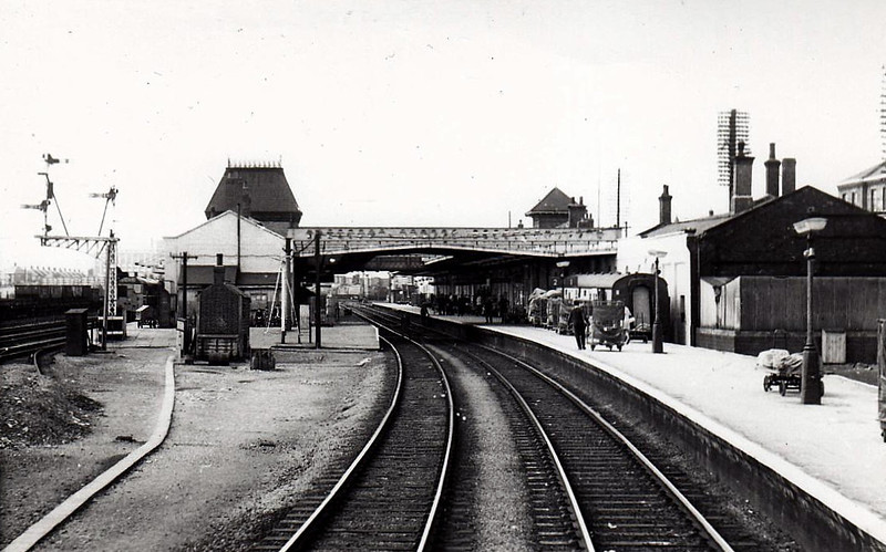PETERBOROUGH NORTH - A most undistinguished station, seen here from the south, looking along the mainlines which were subject to severe speed restrictions. Replaced by a monstrosity in the 1970's, further defaced by forests of steel masts in 1990's, plans are afoot to virtually rebuild the station again.