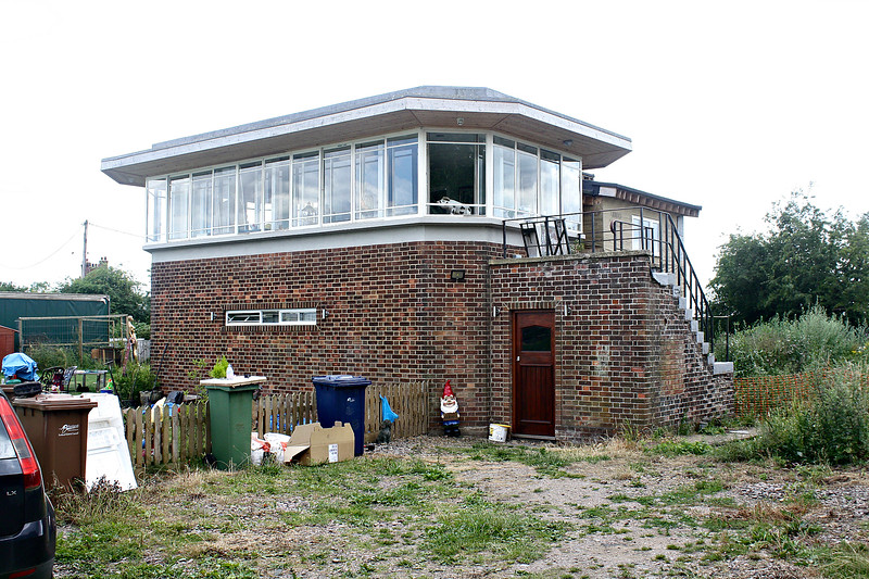 MURROW WEST SIGNALBOX - Built in 1950 to replace the original, which was demolished in an accident - very reminiscent, I think, of 1930's SR boxes. The double tracks of the GN/GE mainline from March to Spalding passed in front of the box with the single M&GN line from Peterborough to Wisbech crossing it on the flat to the right of the steps. The M&GN lines finally closed in 1965 and 1966 and the GN/GE line in November 1982. Seen here on 05/07/17 undergoing conversion to a house.