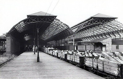LEICESTER BELGRAVE ROAD STATION - Opened in October 1882, the GNR's terminus in Leicester was a rather grand affair. With 5 platforms and a vaulted steel roof lit by hundreds of glass panels, it had of the pretensions of a grand mainline terminus. The only trouble was that it sat at the end of end of a little used branchline! The main passenger services ran to Grantham and Peterborough via the triangular junction at Marefield junction, with local services to Melton Mowbray North. There was never much local traffic, as the area east of Leicester was very sparsely populated, and the Peterborough trains stopped in 1916 as wartime economy and never returned. By 1950, only two Grantham trains and the locals remained. All regular services ended in December 1953. However, on a summer weekend, right up until September 1962, the station burst into life as specials to the East Coast seaside resorts virtually followed each out in the morning and back again in the evening. Thereafter, the site was used as an engineering depot until final closure in January 1969. The site is now occupied by a supermarket - seen here during track lifting in October 1964.
