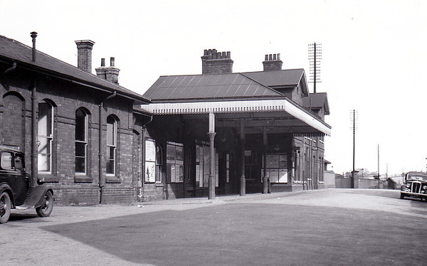 GRANTHAM - Despite the fact that Grantham was one of the major junctions on the Great Northern mainline, this did not mean that famously parsimonious GNR lavished any great deal money on the station buildings. It has the appearance more of a country junction and was fairly typical of GNR architectural flair. Seen here in May 1950.