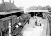 SM - WISBECH EAST - Seen here at some point in 1950's, looking east. The driver of Class D16 No.61514 is about to hand over single line token before proceeding towards March. The platform on the right is of reduced height for use by Wisbech & Upwell Tramway trains, although passenger services were long gone by the time this picture was taken. Nothing now remains of this station.