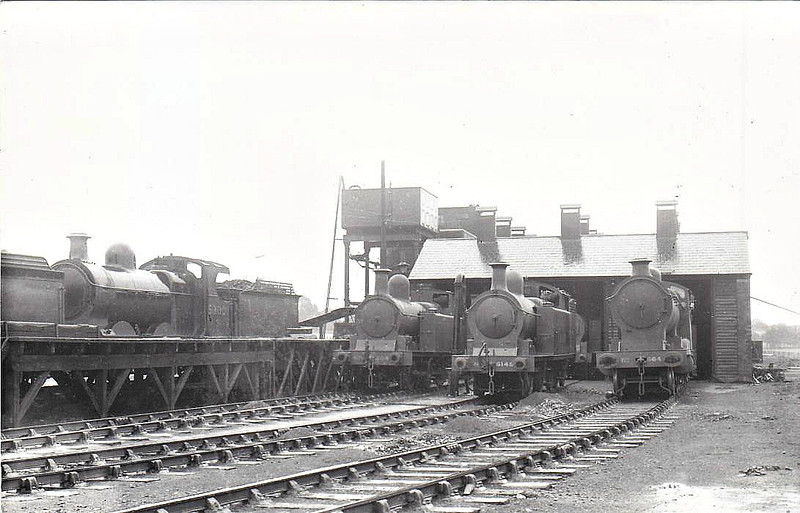 TUXFORD JUNCTION MOTIVE POWER DEPOT - a small freight depot in the heart of rural Nottinghamshire on the old LDECR system. Classified 40D by BR, the depot closed in February 1959. Seen here in July 1930, with an array of ex-GCR freight locos in front of the shed.