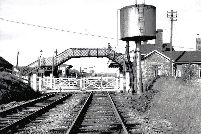 SEATON - a small rural junction in Rutland on the Peterborough (East) - Rugby line, meeting place for the Stamford via Luffenham and Uppingham branch lines - seen here in 1965 after the Uppingham branch had closed (note signals removed) - closed June 1966 - seen here from the west in 1965, the northern end of Harringworth Viaduct just visible between the platforms.