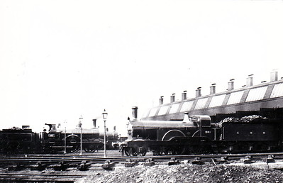 MYSTERY PHOTO 1 - Where is this locoshed? The locomotives in shot are LNWR Precedent Class 2-4-0 No.863 METEOR, GNR Stirling Series 206 2-4-0 No.881 and, in the background, a GER Class T26 2-4-0. METEOR was withdrawn in 1907 and 881 in 1912. Suggestions on the back of the picture are Doncaster, Colwick or Northampton. I wonder if it could be the LNWR shed at Peterborough? That could explain the odd mix of locos.