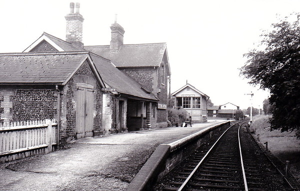 STOW BEDON - Opened in October 1869 by the Thetford & Watton Railway, Stow Bedon was roughly midway between Thetford and Swaffham. It boasted only a single platform and only very rudimentary facilties. To the south of the station there was goods loop and several sidings. The short bay behind the platform was just a headshunt for the yard. The booking office closed in 1923, tickets being issued on the train form this date. It closed in June 1964. Nothing remains today. Looking south, goods yard on the left.